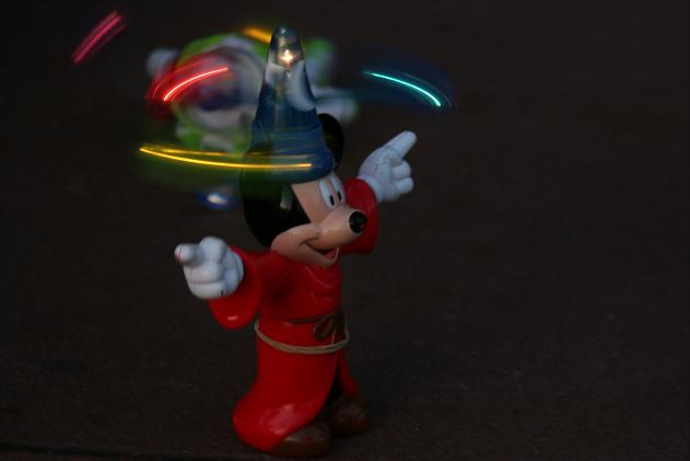 [Who knew Mickey was a fan of the art of glowsticking?]